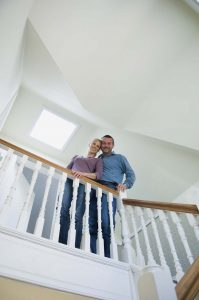 Smiling couple standing on stairs